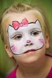 Girl with face painted Stock Images
