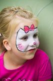 Girl with face painted Royalty Free Stock Images