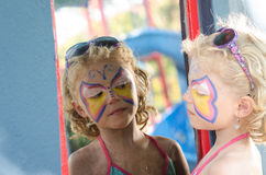 Girl with face painting. Beautiful blond girl with face painting stock image