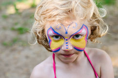 Girl with face painting. Beautiful blond girl with face painting stock images