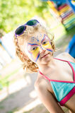 Girl with face painting. Beautiful blond girl with face painting royalty free stock photo