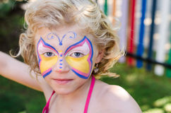 Girl with face painting Stock Image