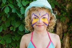Girl with face painting. Beautiful blond girl with face painting royalty free stock photography