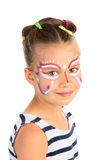 Girl With Face Painting. Head portrait of a little girl with abstract face painting, isolated royalty free stock photos