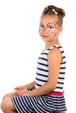 Girl With Face Painting. Little Girl With Abstract Face Painting, Isolated royalty free stock image