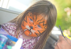 Girl with face painting at Merkinch. Royalty Free Stock Photo