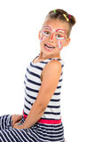 Girl With Face Painting. A portrait of very excited young girl with abstract face painting applied, isolated stock photos