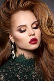 Girl face with a professional stunning makeup. Red lips, false e stock photo