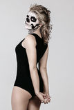 Girl on face of the skeleton Stock Image
