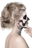 Girl on the face of skeleton Stock Image