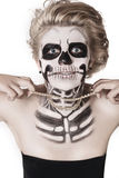 Girl on the face of skeleton Royalty Free Stock Photography