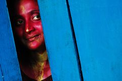 A GIRL FACE SMEARED WITH COLOUR. Close up of a girl's face smeared with red colour during the Holi festival in Kolkata-India Stock Images