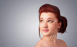 Girl with facial arrows on her skin on gradient background Stock Image