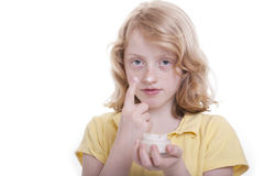 Girl and facial-creme Stock Photos
