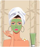 Girl with facial mask. Girl applying facial cosmetic mask Royalty Free Stock Photos