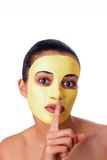 Girl with facial mask Royalty Free Stock Image