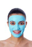 Girl with facial mask Stock Photos