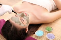 Girl with facial mask lying in beauty health spa center.  Royalty Free Stock Photo