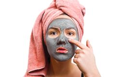Girl with facial mask, mask for skin woman, girl touches finger face mask, funny girl, photo, girl is waiting until the royalty free stock photography