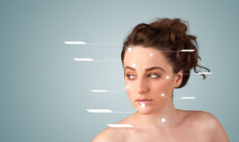 Girl with facial treatment modern arrows Stock Photography
