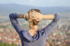 Girl facing the cityview from mountain viewpoint Stock Photography