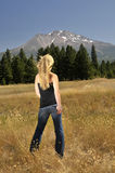 Girl facing mountain Stock Photo