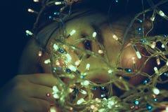 Girl Facing Turned on String Light Stock Images