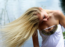 Girl with a fair hair in turn Royalty Free Stock Photography