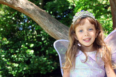 Girl in fairy costume. Outdoor portrait of a young girl wearing a fairy costume with wings and a crown Royalty Free Stock Photos