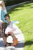 Girl In Fairy Costume Embracing Mother At Park Stock Images