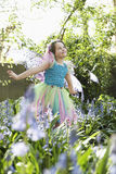 Girl In Fairy Costume At Flower Garden Stock Photography