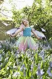 Girl In Fairy Costume At Flower Garden Royalty Free Stock Images