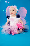 Girl in a fairy costume with soap bubbles Royalty Free Stock Image
