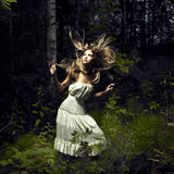 Girl in fairy forest. Portrait of romantic woman at fairy forest royalty free stock photos