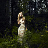 Girl in fairy forest. Portrait of romantic woman at fairy forest stock photos