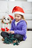 Girl With Fairy Lights During Christmas Royalty Free Stock Images