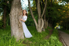 Girl in fairy tale park with tree in spring Royalty Free Stock Images