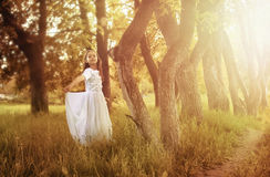 Girl in fairy tale park with tree in spring Stock Photography