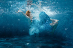 Girl from the fairy tale under water. Stock Image