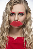 Girl with fake mouth and eyebrows Stock Image