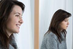 Girl with fake smile. Image of upset girl with fake smile Stock Image