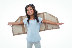 Girl with fake wings pretending to be pilot Royalty Free Stock Photos