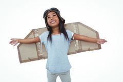 Girl with fake wings pretending to be pilot Royalty Free Stock Photo