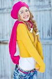 Girl in the fall dressed yellow. And violet cap with hugging hands Royalty Free Stock Photography