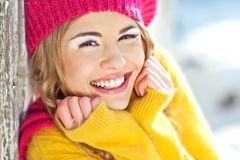 Girl in the fall dressed yellow. And violet cap with hugging hands Stock Photo