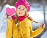 Girl in the fall dressed yellow. And violet cap with hugging hands Royalty Free Stock Photos