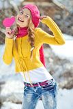 Girl in the fall dressed yellow. And violet cap with hugging hands Royalty Free Stock Images