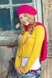 Girl in the fall dressed yellow. And violet cap with hugging hands Stock Photography