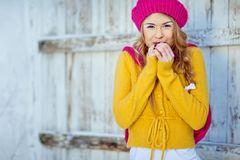 Girl in the fall dressed yellow. And violet cap with hugging hands Stock Photos