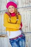 Girl in the fall dressed yellow. And violet cap with hugging hands Stock Image